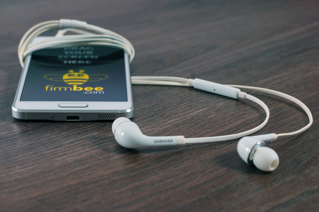 White Samsung with headphones