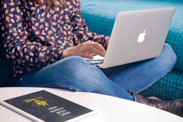 Woman writes on MacBook Air
