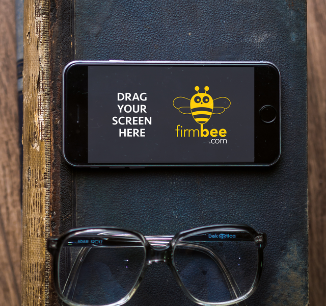 iPhone 6s with glasses and old book psd